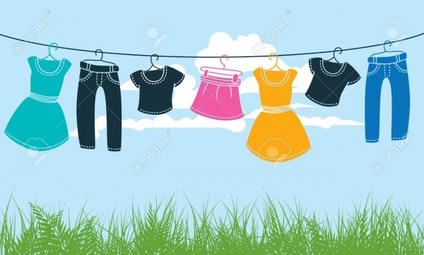 Clothes On Washing Line Against Blue Sky And Green Grass Royalty