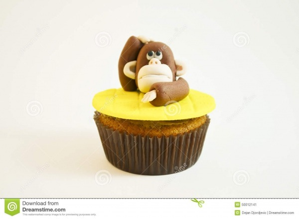 Queque Com Uma Figura Do Macaco Feita Do Fundente Imagem De Stock